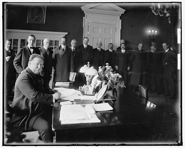 President William Howard Taft signing the bill that made New Mexico a state, in 1912. (Other people in the photo, I have not yet identified). Image from OldPicture.com